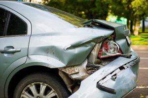 rear left end of car severely damaged